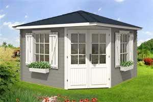Wunderbar Ein Gartenhaus Mit Fensterläden Und Blumenkästen