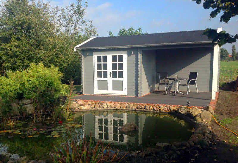 Gartenhaus grau wei moderner gartentrend mit stil for Teichgestaltung im garten